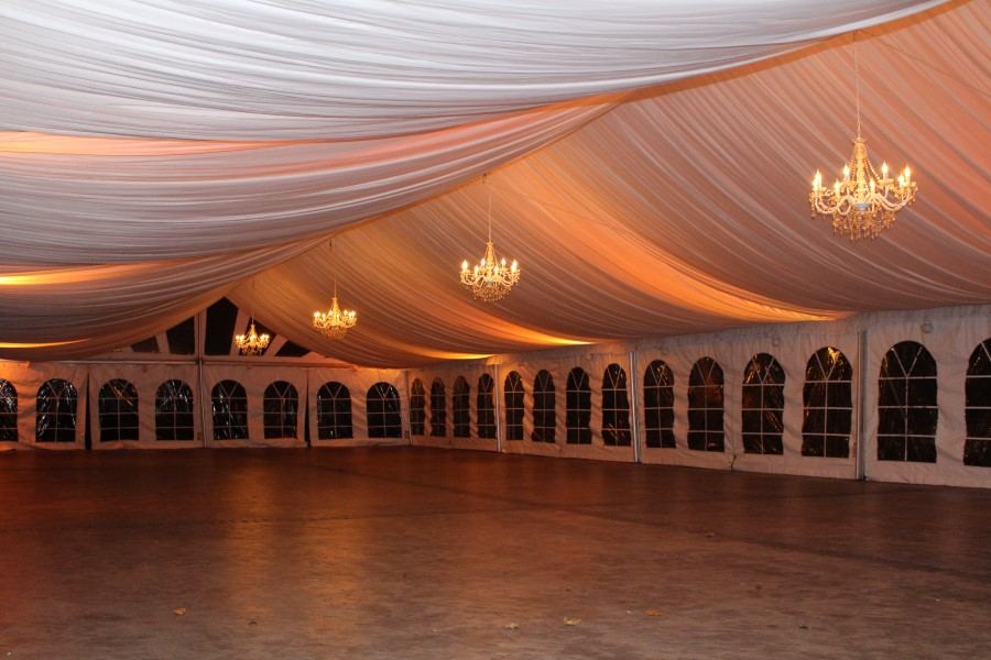 Ceiling Liner in a 40'x100' Frame Tent with Chandeliers and LED's