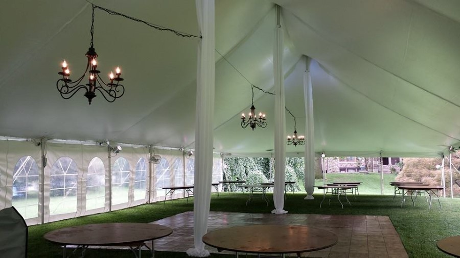 Chandelier Lighting Suspended in a 40' x 100' pole tent with No Ceiling Liner but Fabric Center Pole Covers