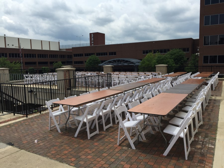 White Padded Resin Folding Chairs at 8' Banquet Tables