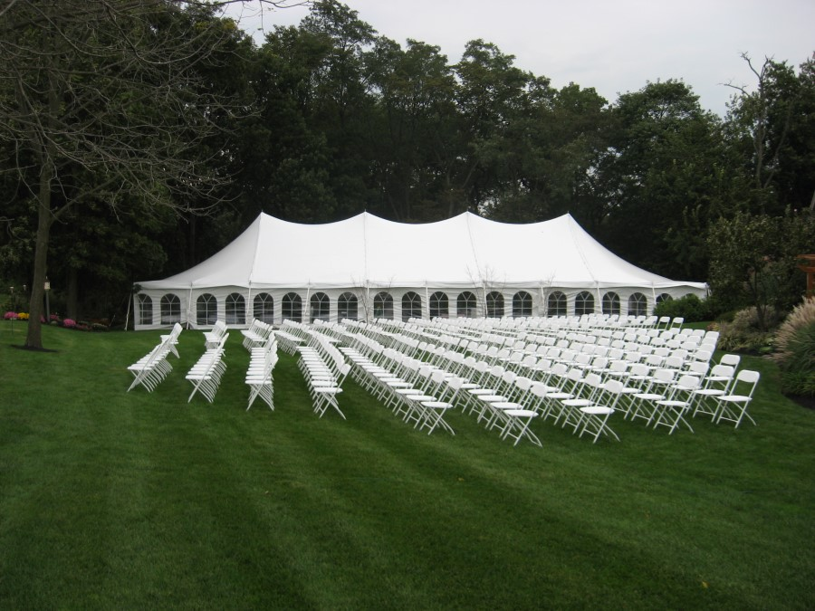 40'x100' Tent with White Folding Chairs for Ceremony
